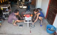Zu Besuch bei Doktor Vy - Motorrad-Werkstatt Luang Prabang